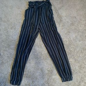 Black and White striped pants.